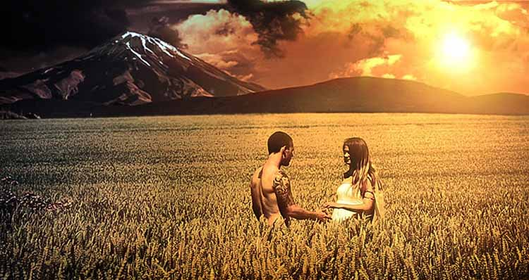 Man and woman in cornfield during epic sunset