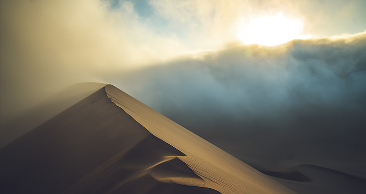 Dune of Peru with sunrise over wall of fog Contrasts of Peru ∙ Sebastian Klinger Cinematographer